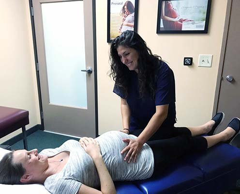 Chiropractor Simi Valley CA Dr. Heather Valinsky with Adult Patient