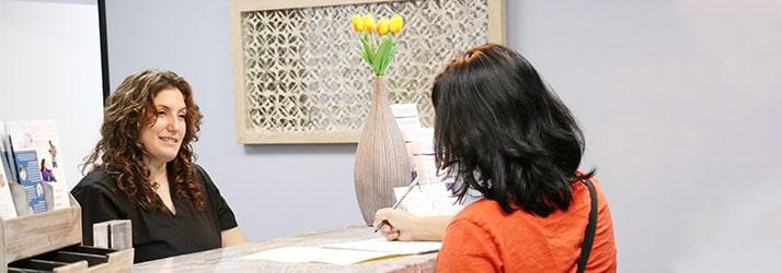 Chiropractor Beverly Hills CA Heather Valinsky at Reception Desk